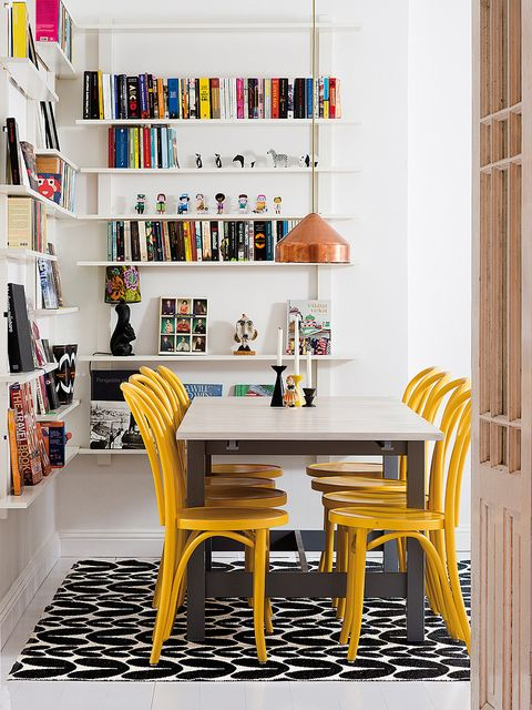 Room, Yellow, Shelf, Interior design, Shelving, Table, Furniture, Chair, Publication, Home,