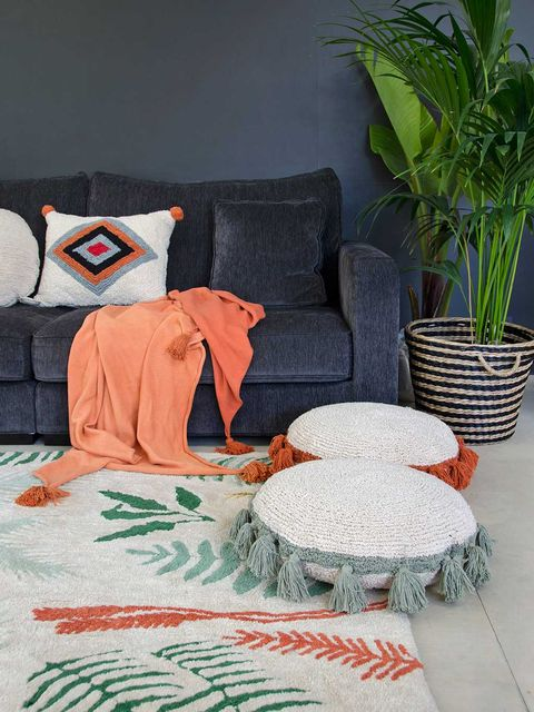 Furniture, Orange, Room, Green, Couch, Living room, Bed sheet, Bedding, Slipcover, Interior design,