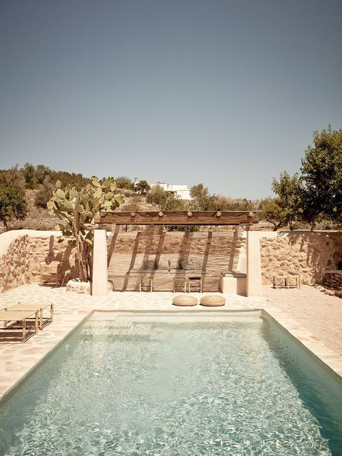 Property, Swimming pool, Wall, Water, House, Building, Architecture, Estate, Vacation, Stone wall,