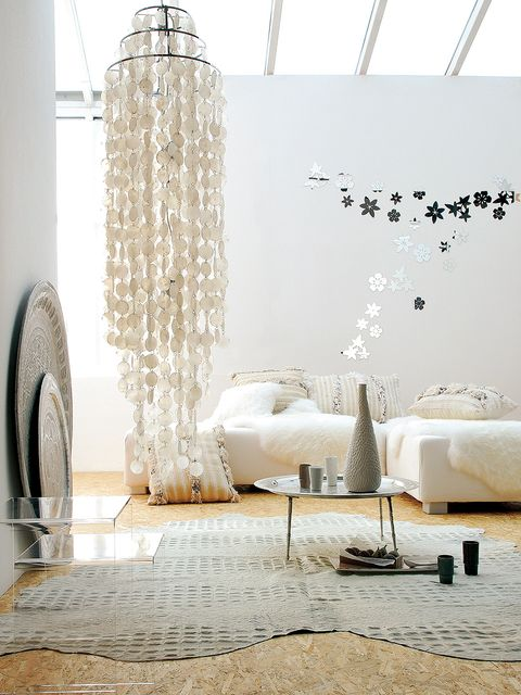 Furniture, Room, Interior design, Wall, Living room, Floor, Table, Lighting, Design, Coffee table,
