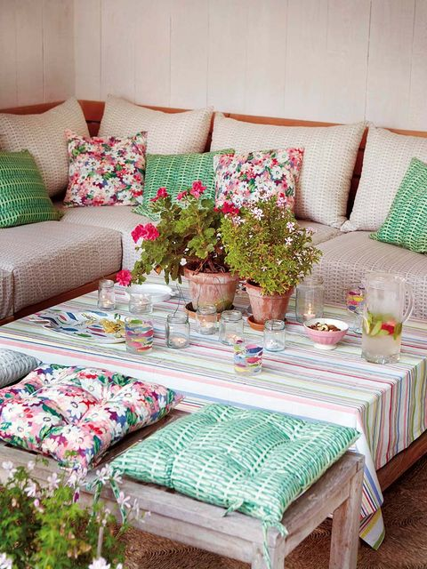Room, Interior design, Green, Furniture, Textile, Living room, Tablecloth, Table, Pink, Turquoise,
