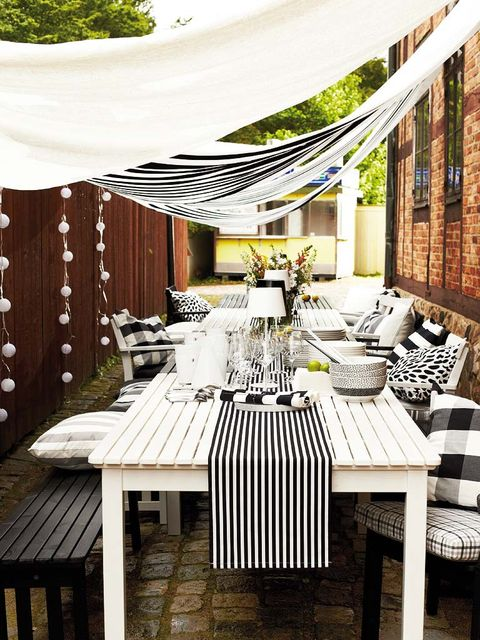 Table, Furniture, Outdoor table, Linens, Tablecloth, Outdoor furniture, Hardwood, Shade, Kitchen & dining room table, Restaurant,