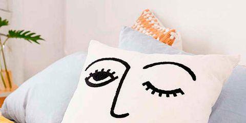 Orange, Textile, Linens, Bedding, Bed sheet, Cushion, Cone, Creative arts, Houseplant, Pillow,