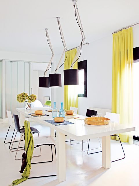 Yellow, Interior design, Room, Floor, Table, Interior design, Material property, Curtain, Design, Window treatment,