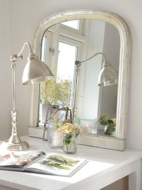 Room, Interior design, Light fixture, Arch, Metal, Lamp, Flower Arranging, Vase, Mirror, Still life photography,