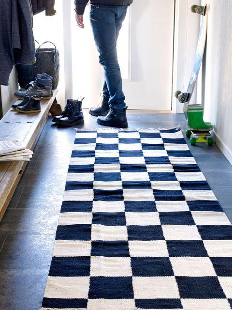 Floor, Flooring, Trousers, Textile, Denim, Jeans, Human leg, Tile, Jacket, Grey,