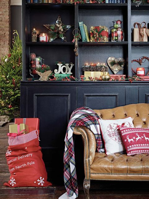 Red, Room, Interior design, Shelving, Interior design, Shelf, Throw pillow, Living room, Picture frame, Boot,