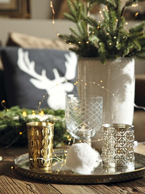 Centrepiece, Table, Glass, Tree, Christmas decoration, Tableware, Christmas, Branch, Room, Tablecloth,