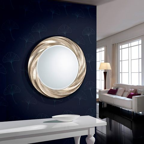 Mirror, Room, Interior design, Lighting, Wall, Circle, Furniture, Window, Table, Material property,