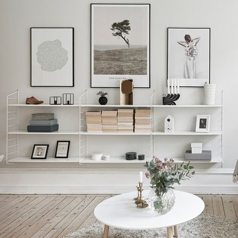Room, Interior design, Table, Furniture, Wall, Interior design, Home, Grey, Shelving, Picture frame,