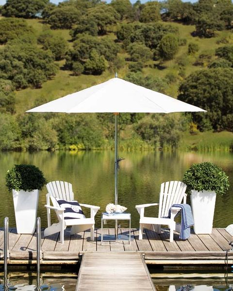 Furniture, Chair, Outdoor furniture, Shade, Garden, Outdoor table, Gazebo, Outdoor structure, Reservoir, Landscaping,