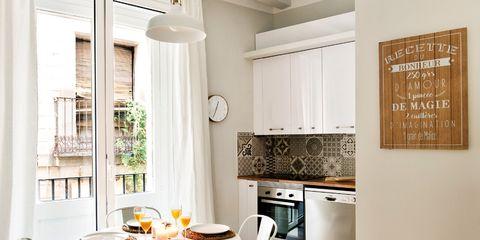 Furniture, Room, Floor, Interior design, Wood flooring, Dining room, Property, Table, Yellow, Laminate flooring,