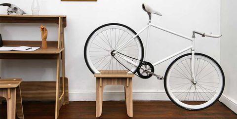 Bicycle wheel, Wall, Bicycle, Bicycle part, Shelf, Floor, Furniture, Room, Vehicle, Table,
