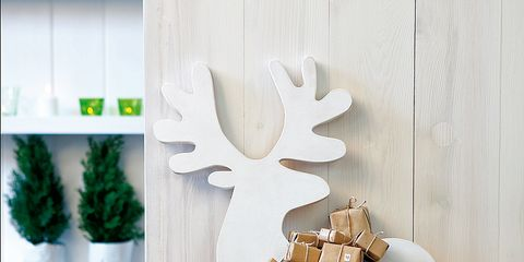 Lighting, Wall, Interior design, Candle, Antler, Design, Natural material, Wax, Wall sticker, Cylinder,