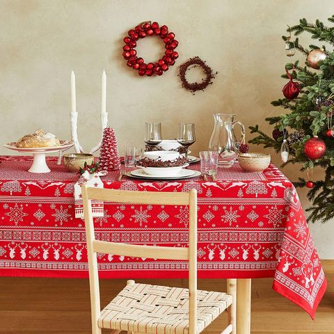 Red, Table, Tablecloth, Christmas decoration, Furniture, Textile, Room, Christmas eve, Linens, Interior design,