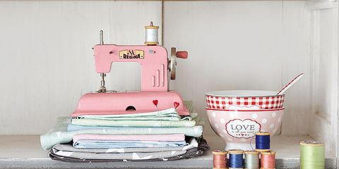 Textile, Shelving, Linens, Paper, Dishware, Household supply, Paper product, Serveware, Home accessories, Banknote,