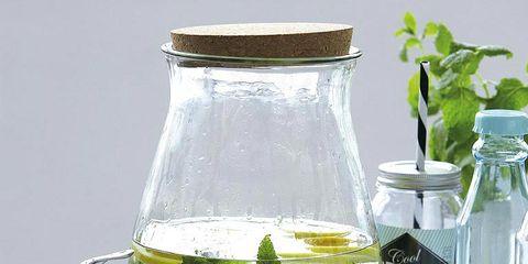 Liquid, Fluid, Glass, Lemon, Ingredient, Bottle, Citrus, Transparent material, Drinkware, Serveware,