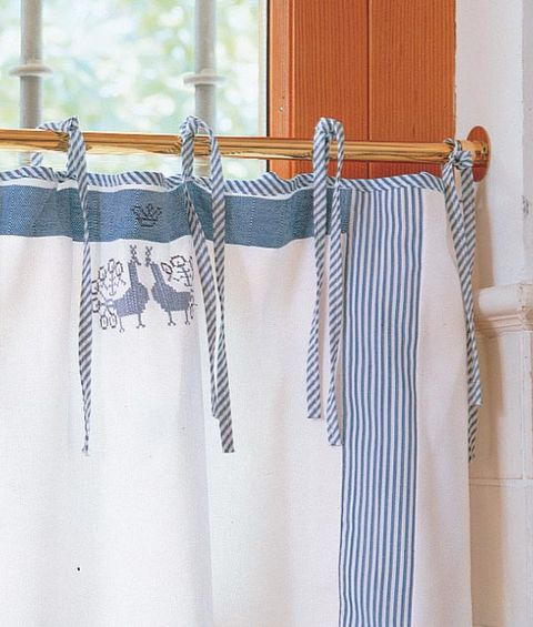 Blue, Textile, Clothes hanger, Beige, Linens, Fashion design, Stitch, Embroidery, Natural material, Undergarment,