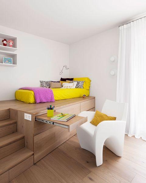 dormitorios infantil con cama en altura y escritorio oculto