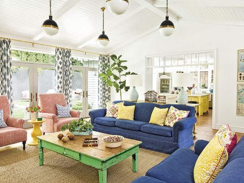 Living room, Room, Furniture, Interior design, Green, Property, Blue, Yellow, Coffee table, Home,