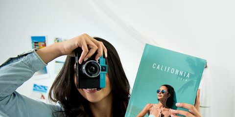 Eyewear, Vision care, Hand, Lens, Wrist, Teal, Turquoise, Goggles, Cameras & optics, Publication,