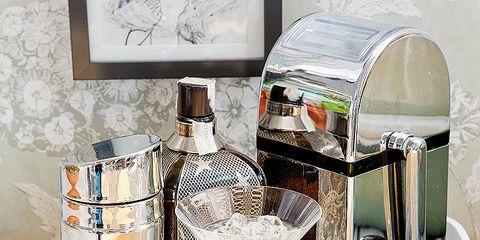 Perfume, Barware, Glass, Bottle, Glass bottle, Drinkware, Serveware, Picture frame, Stemware, Champagne stemware,