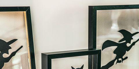 Black cat, Black, Pumpkin, Room, Black-and-white, Interior design, Cat, Table, Picture frame,