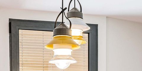 Lighting, Yellow, Ceiling fixture, Light fixture, Wall, Lighting accessory, Electricity, Amber, Interior design, Light,