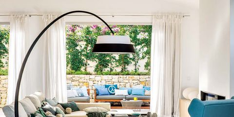Living room, Room, Furniture, Interior design, Floor, Wood flooring, Laminate flooring, Blue, Turquoise, Property,