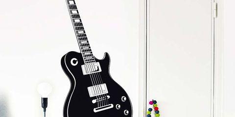 Plucked string instruments, String instrument, String instrument, Musical instrument, Guitar, Musical instrument accessory, Room, String instrument accessory, Wall, Folk instrument,