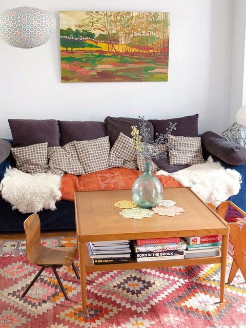 Blue, Room, Interior design, Living room, Furniture, Table, Home, Interior design, Pillow, Throw pillow,