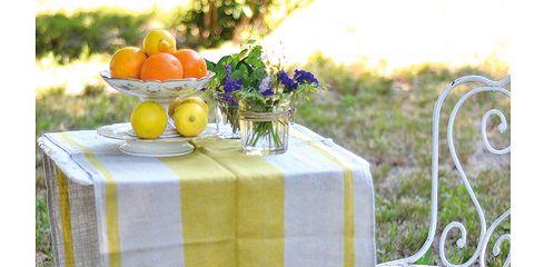 Tablecloth, Tangerine, Grapefruit, Table, Citrus, Outdoor table, Outdoor furniture, Mandarin orange, Tangelo, Orange,