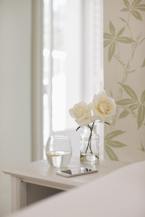 White, Curtain, Interior design, Room, Yellow, Wall, Furniture, Window treatment, Textile, Table,