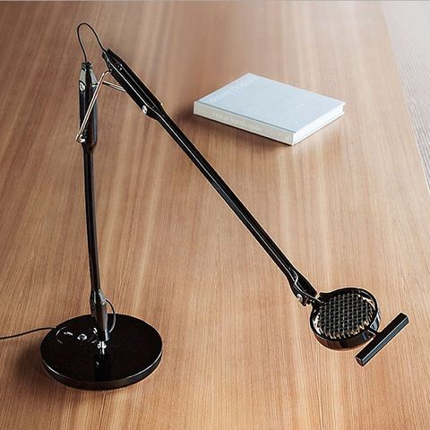 Hardwood, Iron, Metal, Still life photography, Circle, Audio accessory, Shadow, Microphone stand, Office supplies, Steel,