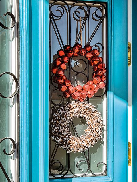 Turquoise, Wreath, Door, Christmas decoration, Fashion accessory, Metal, Interior design,