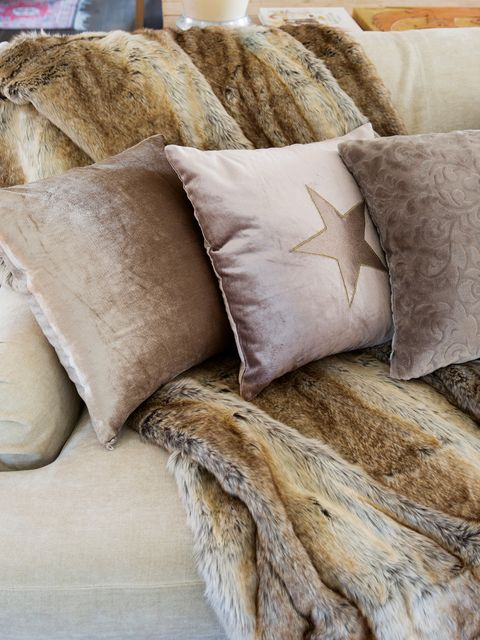 Fur, Bedding, Furniture, Pillow, Textile, Cushion, Room, Beige, Linens, Interior design,
