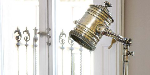 Room, Metal, Home accessories, Serveware, Brass, Interior design, Cylinder, Plate, Silver, Lamp,