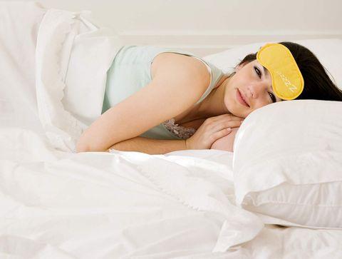White, Skin, Beauty, Leg, Nose, Yellow, Sleep, Arm, Bedding, Textile,
