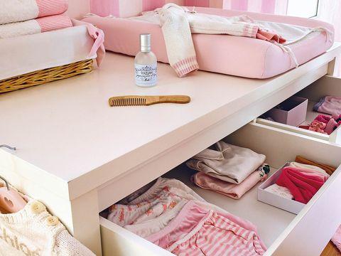 Room, Interior design, Pink, Linens, Home, Shelving, Beige, Peach, Interior design, Home accessories,