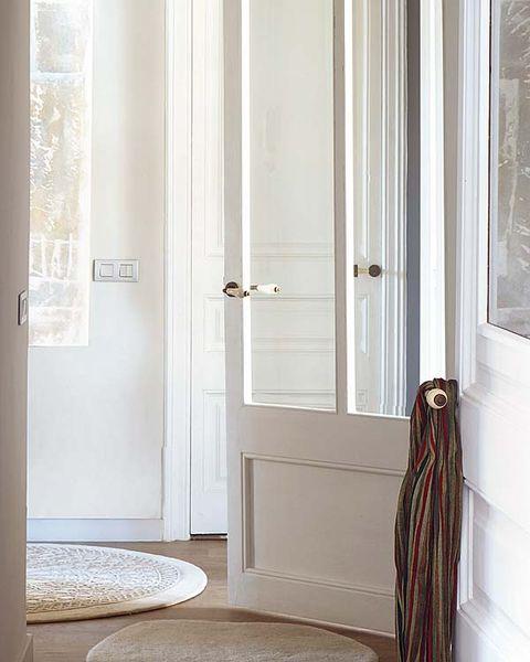 Room, Floor, Interior design, Door, Home door, Flooring, Fixture, Door handle, Handle, Molding,