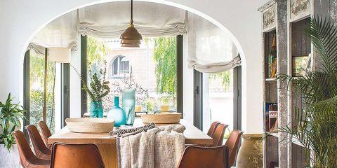 Interior design, Furniture, Light fixture, Houseplant, Arch, Flowerpot, Wicker, Home accessories, Chandelier, Outdoor furniture,