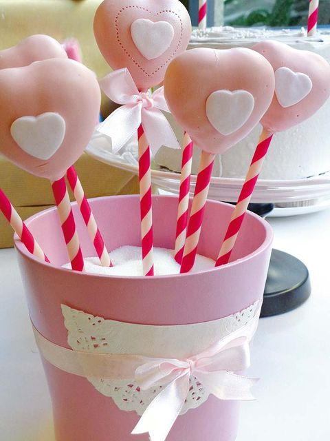 Party supply, Pink, Ribbon, Confectionery, Carmine, Candy, Stick candy, Present, Dessert, Dishware,