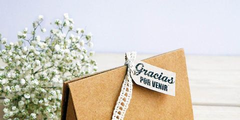Tan, Beige, Khaki, Paper product, Paper, Cardboard, Floral design, Label,