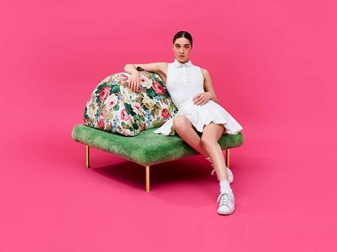 Pink, Sitting, Green, Furniture, Leg, Footwear, Fashion model, Shoulder, Photo shoot, Joint,
