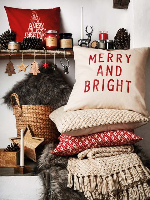 Christmas stocking, Room, Bedding, Furniture, Textile, Interior design, Linens, Cushion, Font, Pillow,