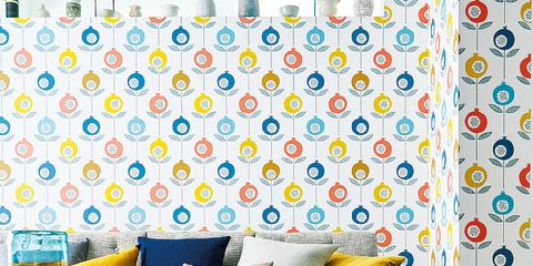Blue, Yellow, Room, Interior design, Furniture, Couch, Living room, Wall, Pattern, Orange,