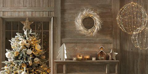 Living room, Room, Christmas tree, Christmas decoration, Fireplace, Interior design, Hearth, Furniture, Wall, Ornament,