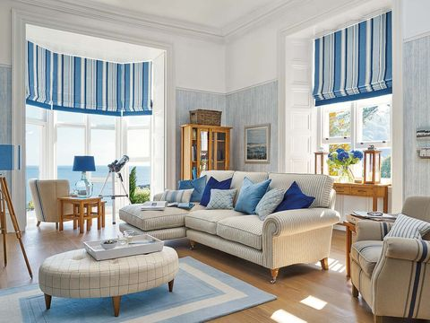 Living room, Furniture, Room, Blue, Interior design, Property, Coffee table, Home, Building, Table,