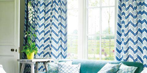 Blue, Interior design, Room, Green, Living room, Textile, Home, Wall, Floor, White,