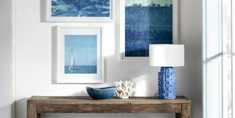 Blue, Furniture, Room, Shelf, Table, Interior design, Wall, Material property, Desk, Shelving,